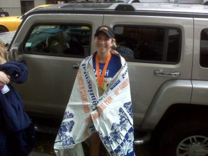A satisified Sarah Tantillo at finish line of the NYC Marathon. Hey, is that a Heatsheets blanket?