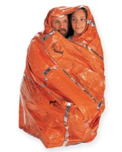 Treat hypothermic victims by wrapping them in blankets