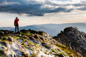 1-hiker_overlooking-mountainscape