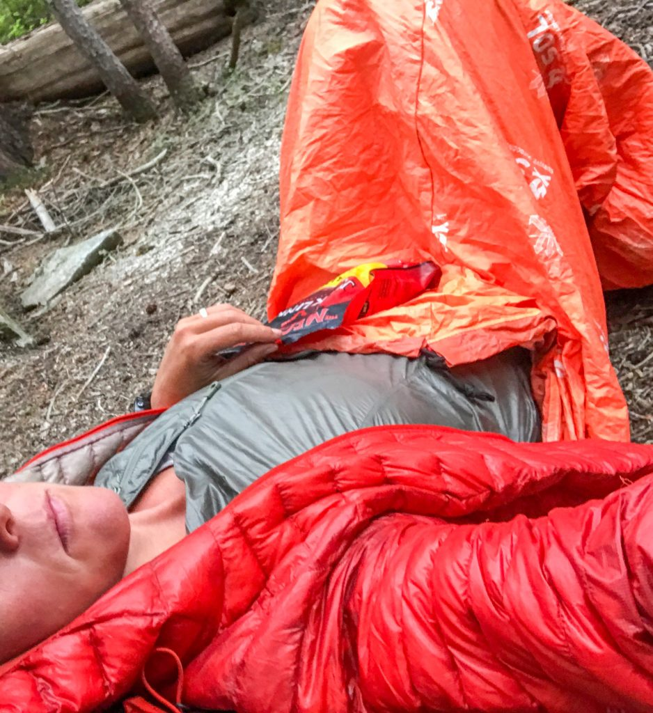 woman in escape bivvy