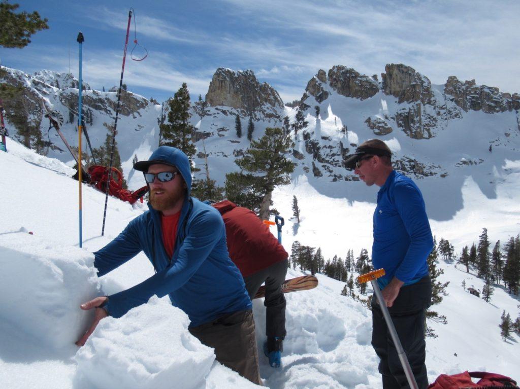 skier assessing snowpack
